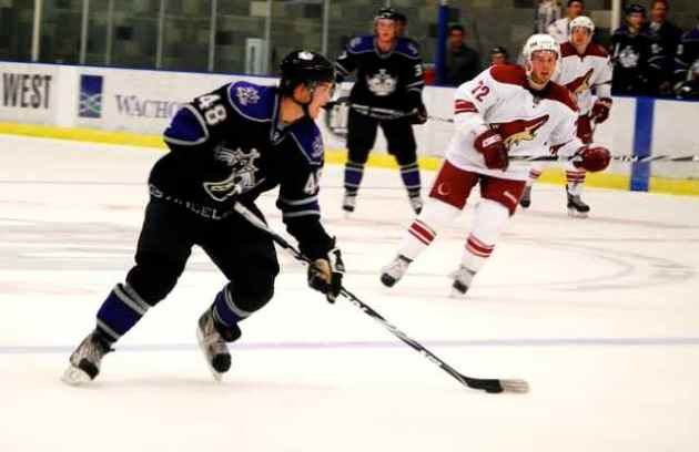 Los Angeles Kings center prospect Andrei Loktionov carries the puck in a 6-1 loss against Phoenix Coyotes prospects on September 10, 2009. Photo courtesy Thomas LaRocca/LAKings.com.