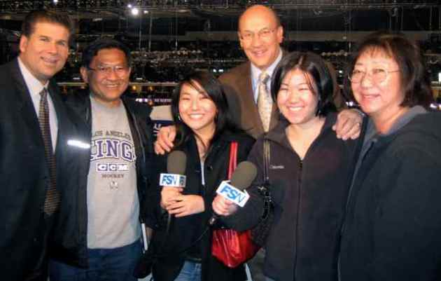 "Los Angeles Kings fan Stacy Iwata (third from left) and her family visit with ""Voice of the Kings"" Bob Miller and Jim Fox in the broadcast booth. Photo courtesy Stacy Iwata"