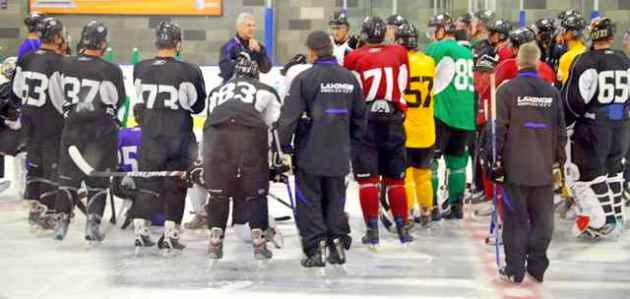 Head Coach Terry Murray surrounded by young prospects at the team's Rookie Camp. Photo courtesy Thomas LaRocca/LAKings.com.