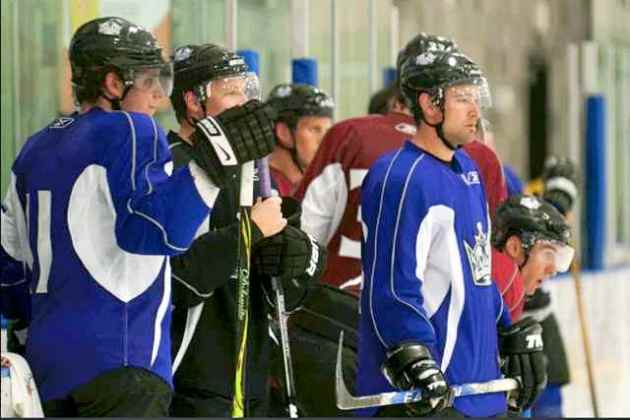 Anze Kopitar (left) and Justin Williams (purple jersey, at right) look on during drills at the LA Kings 2009-10 Training Camp. Photo courtesy Los Angeles Kings.