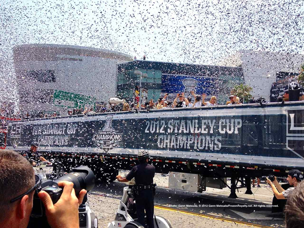 7e88dc310 Confetti flies in the air as a truck carrying Los Angeles Kings players
