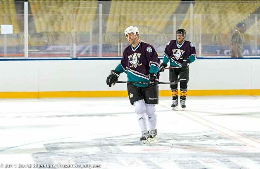 Sean O'Donnell, wearing a Ducks jersey, with Kings pants and helmet.