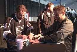 Defenseman Jake Muzzin signs an autograph