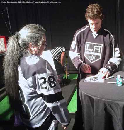 Center Colin Fraser signs an autograph for a fan
