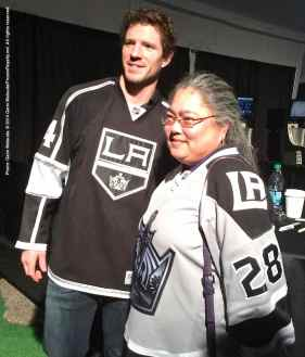 Center Colin Fraser poses for a photograph with a fan