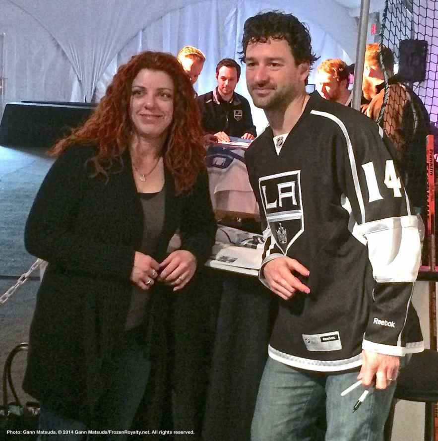 Right wing Justin Williams poses for a photograph with a fan