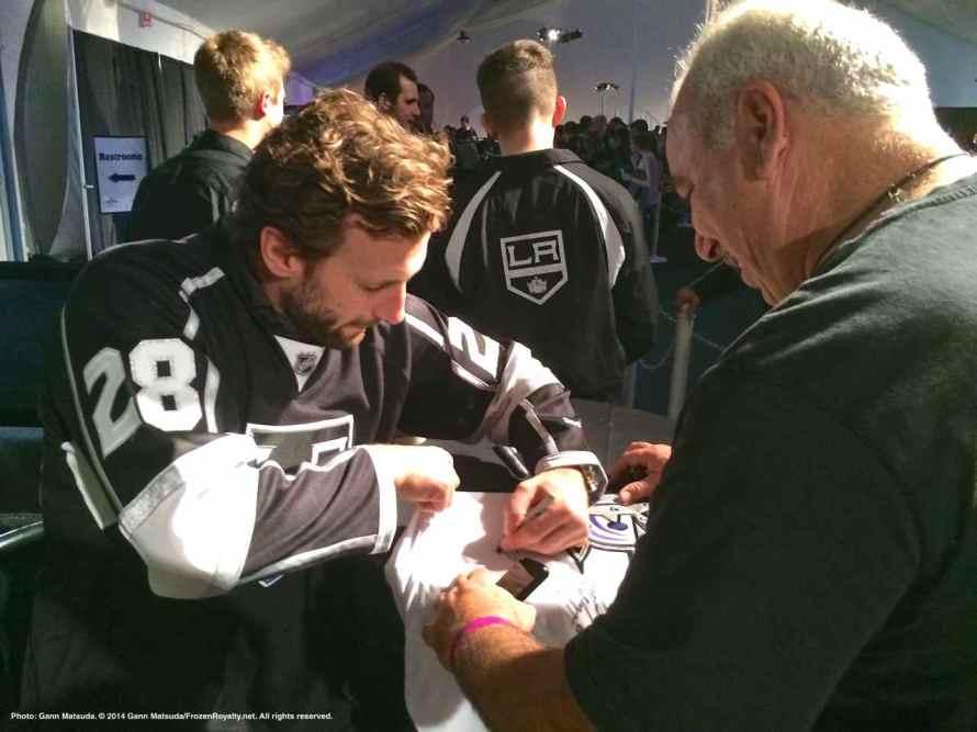 Center Jarret Stoll autographs a jersey for a fan