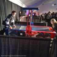 Right wing Matt Frattin face-off with fan Lizzie Muse in a game of air hockey.