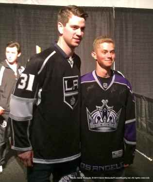 Goalie Martin Jones poses for a photo with a fan