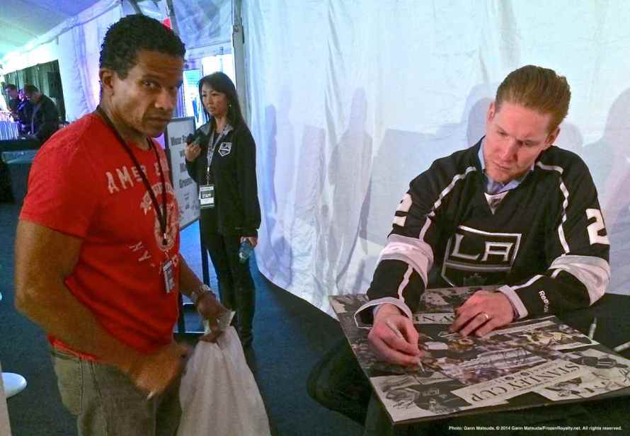 Defenseman Matt Greene signs an autograph for a fan