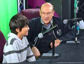 Hall of Fame TV play-by-play announcer Bob MIller with a young fan