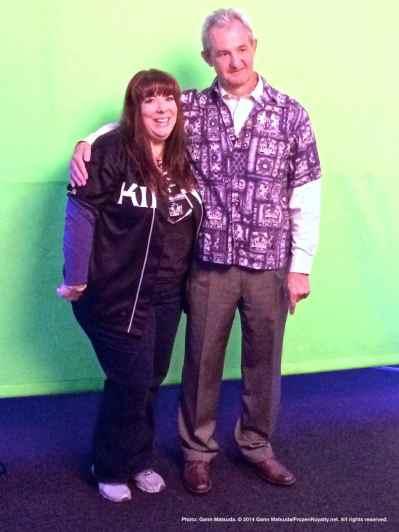 Head coach Darryl Sutter poses for a photo with fan TJ Deperez