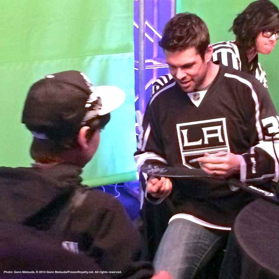 Defenseman Willie Mitchell with a fan