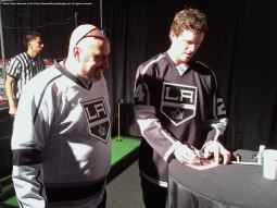 Center Colin Fraser with a fan