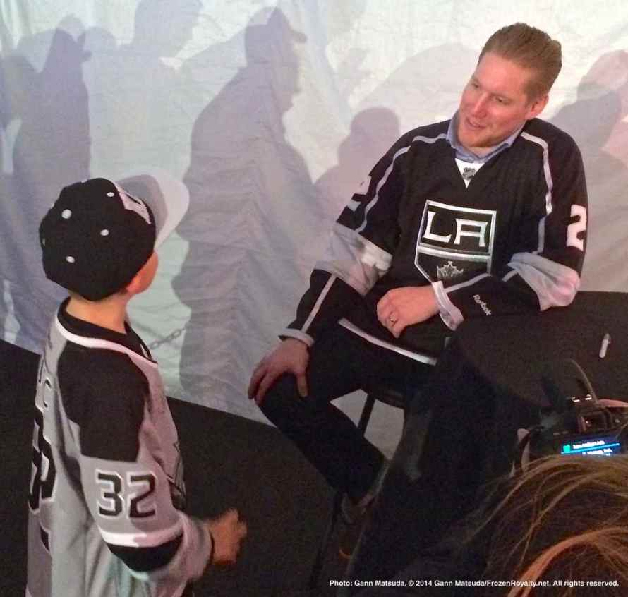 Defenseman Matt Greene with a young fan