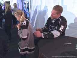Defenseman Matt Greene with a young fan