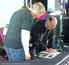 Hall of Fame TV play-by-play announcer Bob MIller with a fan