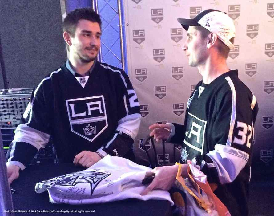 Defenseman Slava Voynov with a young fan