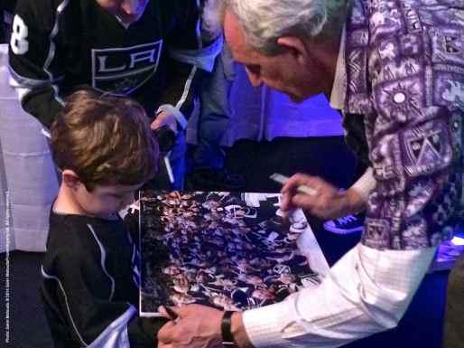 Head coach Darryl Sutter signing an autograph