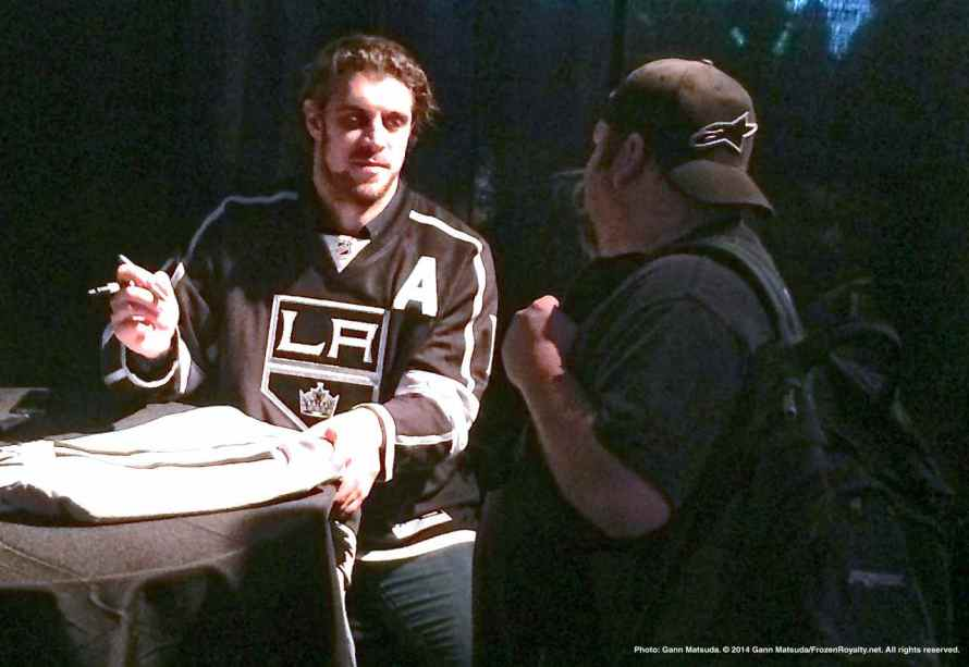 Center Anze Kopitar signing an autograph