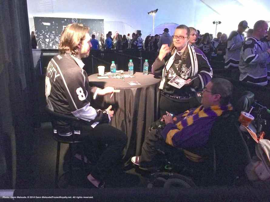 Defenseman Drew Doughty with fans Laurie (center) and Ian (foreground right) Dow