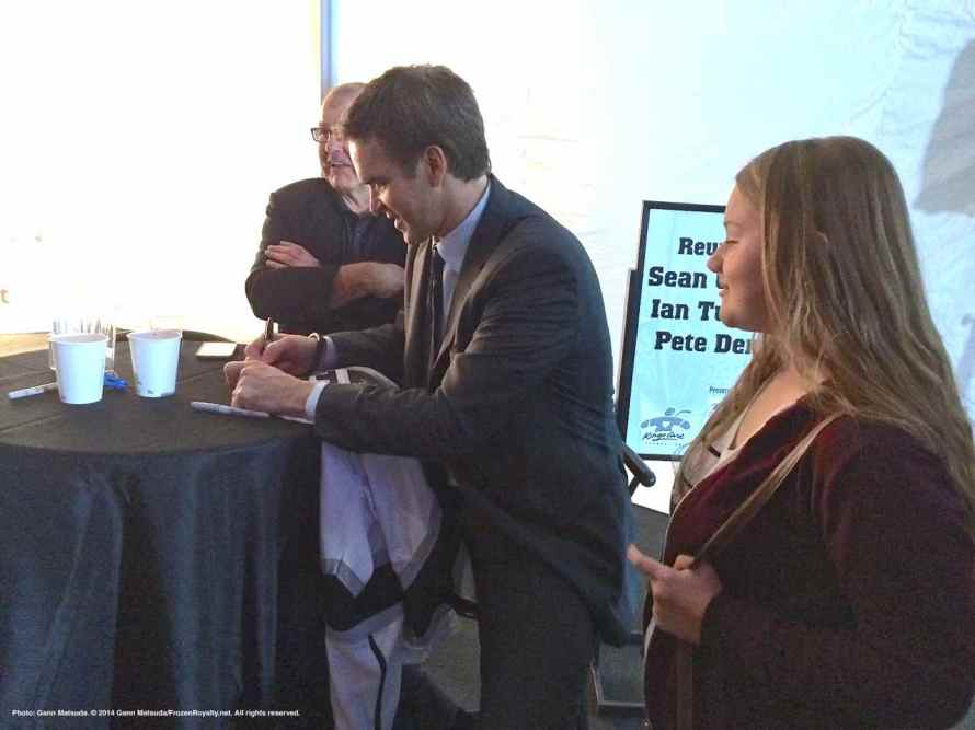 Kings President/Business Operations Luc Robitalle signs an autograph