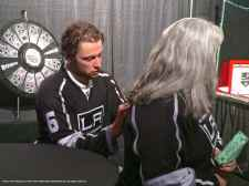 Defenseman Jake Muzzin signs a jersey