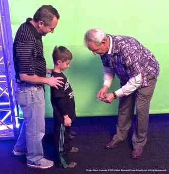 Head Coach Darryl Sutter greets a young fan
