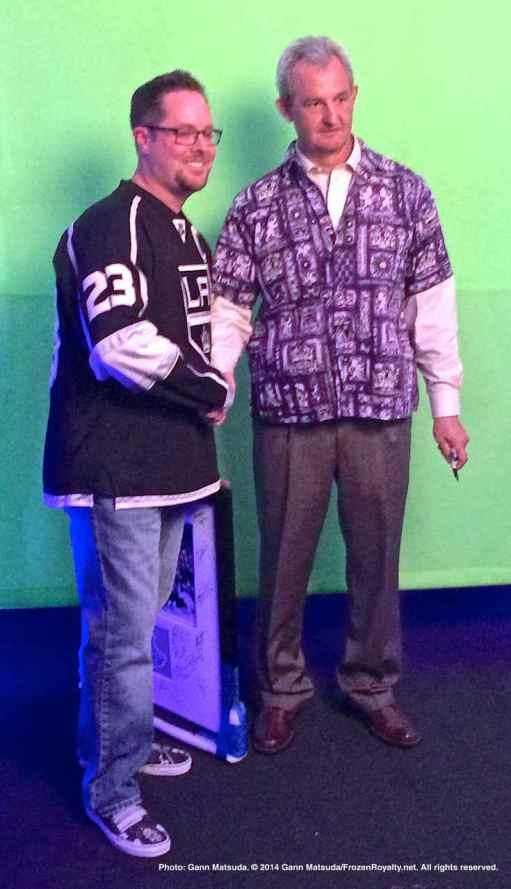 Head coach Darryl Sutter with a fan