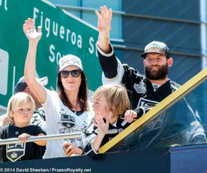 Defenseman Robyn Regher (right) and family