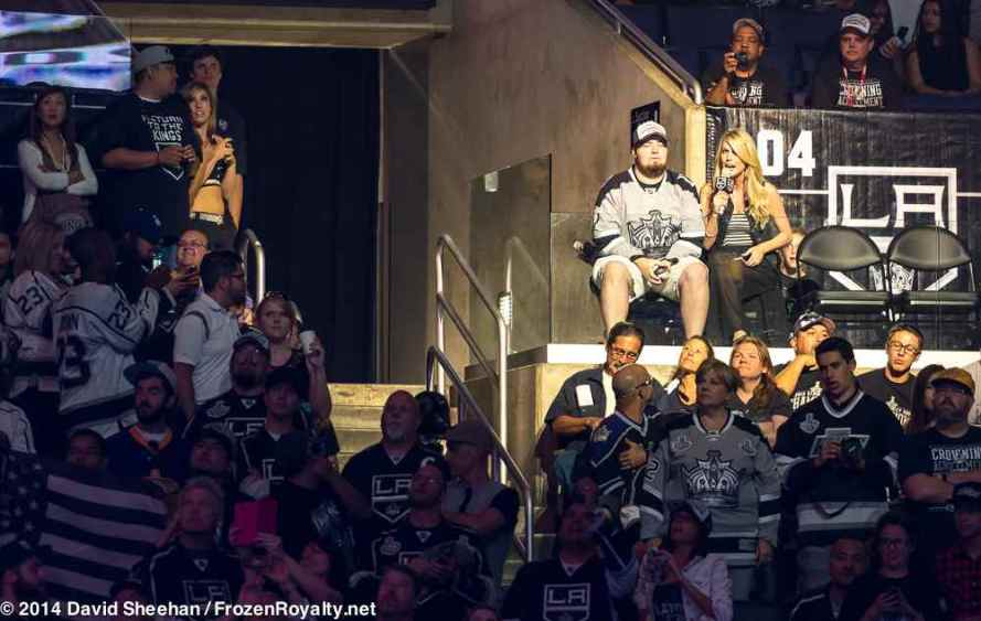 A fan answers trivia questions posed by LA Kings in-arena host Carryln Bathe (spotlighted, right).
