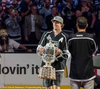 Center Anze Kopitar carries the Clarence Campbell Bowl onto the ice.