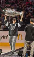 Forward and captain Dustin Brown carries the Stanley Cup onto the ice.