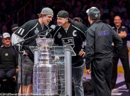 Center Anze Kopitar (left) and forward Dustin Brown (center) answer an important question posted by President/General Manager Dean Lombardi (right(