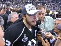 Captain Dustin Brown speaks to the media