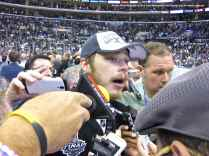 Captain Dustin Brown speaks to the media