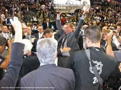 Former LA Kings right wing and current Development Consultant Glen Murray hoists the Stanley Cup