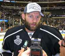 Defenseman Robyn Regehr speaks to the media.