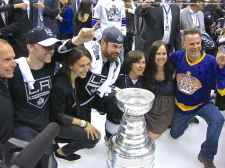 Defenseman Willie Mitchell and family pose with the Stanley Cup
