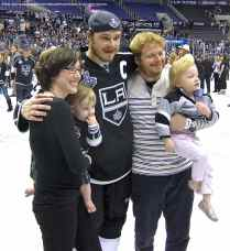 Captain Dustin Brown with relatives