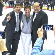 LA Kings television play-by-play announcer Bob Miller (right), shown here with television color commentator Jim Fox (left) and Fox Sports West stage manager Donna Moskal