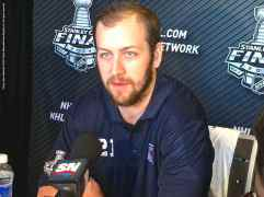 New York Rangers forward Derek Stepan, shown here speaking to the media during the 2014 Stanley Cup Final Media Day at Staples Center in Los Angeles, June 3, 2014.