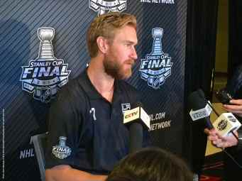 Los Angeles Kings forward Jeff Carter, shown here speaking to the media during the 2014 Stanley Cup Final Media Day at Staples Center in Los Angeles, June 3, 2014.