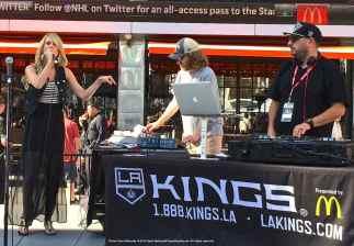 LA Kings Arena Host Carrlyn Bathe (left) and Music Director Dieter Ruehle (center).