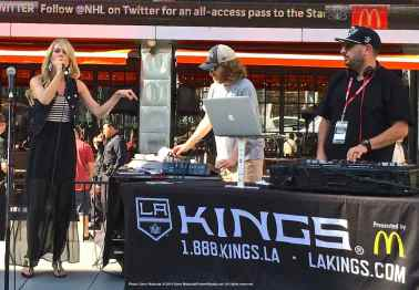 LA Kings Arena Host Carrlyn Bathe (left) and Music Director Dieter Ruehle (center).