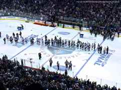View from the press box: the handshake line...the best tradition in professional sports.