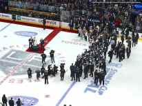 View from the press box: NHL Commissioner Gary Bettman presents the Stanley Cup to Los Angeles Kings captain Dustin Brown