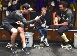 """You're friends with him?"" — LA Kings goaltender Martin Jones (left), joking with nine-year old cancer patient Grace Bowen about right wing Justin Williams (right)."